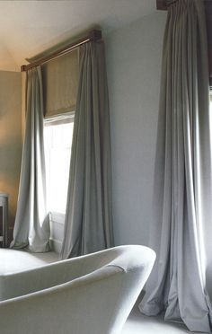 Luxury but plain curtains and matching blinds. They will be a big part of the room, so will make impact enough being plain. Patter will be too much