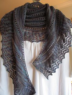 Simple pattern repeats make this picturesque crescent shaped shawl as beautiful to knit as the coastline itself, with continuous waves pounding against the cliffs and rocky coast sending sprays of saltwater into the air. The water pattern repeat throughout the body continues evenly, until reaching the knitted on lace edge of the crashing waves. If you listen quietly you'll hear the water in the distance and taste the salt in the air!