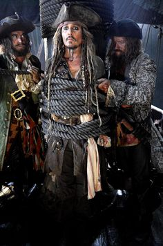 "Johnny Depp is back at work as the sauced hero Captain Jack Sparrow in the fifth installment of Disney's popular Pirates of the Caribbean franchise. ""Captain Jack is back and we're not letting him go,"" producer Jerry Bruckheimer tweeted Tuesday. In the photo, Depp's character looks decidedly panicked as he's tied up by thick ropes and flanked by two menacing pirates."