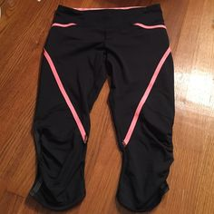 Lululemon run pace crop EUC. wore once, no signs of wear or damage. Black crops with sun bleached coral designs. lululemon athletica Pants
