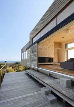 family beach house along the coastal waters of St Andrews Beach by Perkins Architects