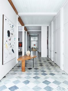 The elegant entry of a Manhattan loft, with marble tiles and modern art via @thouswellblog