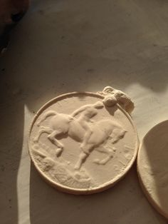 Plaster cast made from Alginate mould of WW1 medal.