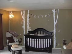 I looove wall stickers of trees! I love the idea of pinning a banner with their name on it between them!