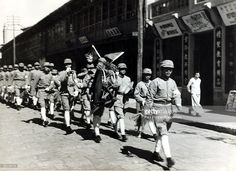 Nationalist soldiers pictured in Yunnan Fu, The conflict between Nationalist and Communist forces began with the U,S,A, aiding the Nationalists who were generally better armed, but their troops were no match for the Communists, the Peoples Liberation Army, who by 1949 had entered Beiping (Beijing) and forced Chiang Kai-shek and the remainder of the Nationalist forces to flee to Taiwan