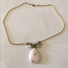 """Pink stone necklace Beautiful pink stone necklace with black flecks. White and green stones above. On a non tarnishing, gold plated chain. 16"""" Jewelry Necklaces"""
