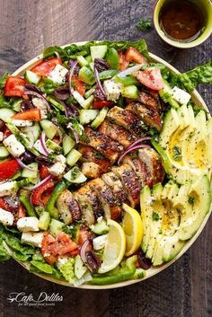 Loaded Greek Chicken Avocado Salad is another meal in a salad! Full of Greek flavours and a 5-ingredient dressing that doubles as a marinade!