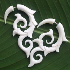 White Organic Fake Gauges  INFERNO Earrings  Hand by SanskritDream, $23.00. These would look really wierd on me, but they're still sweet!