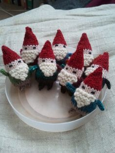 little knit gnomes -- I'm tempted to knit dozens of these and hide them in other peoples' houses.