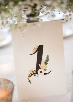 Floral Table Numbers Calligraphy for your Wedding 1-15. $75.00, via Etsy.