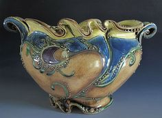 The spirals, swirls, scrolls and waves of Carol Long's pottery.  August 9, 2012