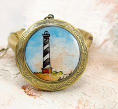 Lighthouse at Hatteras -- Watercolor Painting Locket by Sarah-Lambert Cook http://www.sarahlambertcook.com/collections/lockets/products/lighthouse-at-hatteras-watercolor-painting-locket#