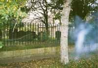 This is a photo of mine taken a few years ago in York, England. It was with a normal camera. It is as you can see a photo of a cemetry. It was about 3pm in the afternoon. The weather was dry and clear with no fog. There was no fire or smoke.The image is also on the negative and the photo taken before and after this one were clear.