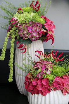 Flower Arrangement with hot pink and green. Gloriosa lilies, hanging amaranthus