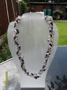 pearl plaited necklace   This necklace is made of strand of Purple Fluorite chips ,strand of hematite chips ,strand of Purple Amethyst chips and pearl nuggets all plated together and finished with Silver Plaited copper wire handmade hook and jump ring  Great to wear every day or Gift for someone special..  Your jewellery will come with a pretty fabric drawstring bag for safe-keeping or gift-giving  £140.59