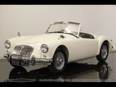 1958 MG MGA Roadster I had one just like this only I painted 2 blue racing stripes down the mid right center. Wish I had it back. 1965-68