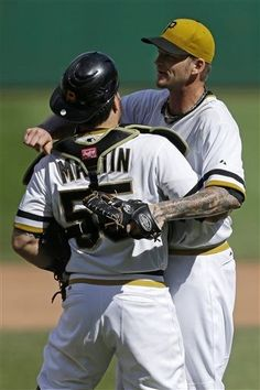 August 4, 2013 — Pittsburgh Pirates starting pitcher A.J. Burnett, right, and catcher Russell Martin celebrate Burnett's complete game 5-1 win over the Colorado Rockies at PNC Park.