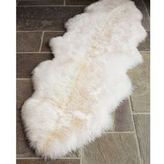 Pottery Barn Sheepskin Rug ($199) ❤ liked on Polyvore featuring home, rugs, cream area rug, textured rug, pottery barn, plush area rugs and cream rug