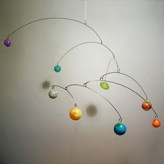 This is exactly what I want hanging over the baby's crib. Judith Frith's planets mobile.