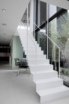 Super-thin hanging stairs with risers.  They must be metal.