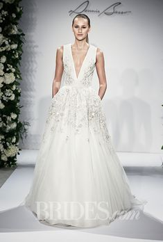 "Brides: Dennis Basso - Fall 2015. ""First Lady"" sleeveless silk organza and tulle A-line wedding dress with a plunging v-neckline and beaded details, Dennis Basso"