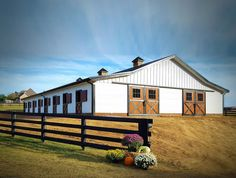 Beautiful 16 stall horse barn with double breezeways, tack rooms, wash & groom bay and an office - dream barn!