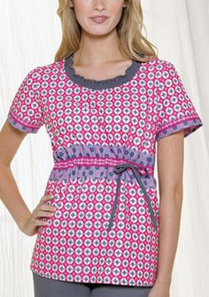 """Smocked Round Neck in Dots Daisy A Junior fit smocked round neckline top features an adjustable front tie, back elastic, side angled pockets and side vents. Center back length: 26 1/2"""".  Fabric: 100% Cotton $26.99 #scrubs #nurses #doctors #medicaloutlet #dickies"""