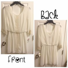 NWT White Dress w/Cream Accents Brand new with tags. Dress is white with light tan embroidery around sleeves and down the front. V-shape in the back, sheer effect around the top, lined in the skirt. Dresses Long Sleeve