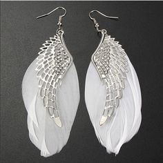 Angel Wings Earrings✨7 available✨ Pretty silver toned zinc alloy earrings with white feathers. Feathers may vary in size and shape due to them being actual feathers. New in package. Jewelry Earrings