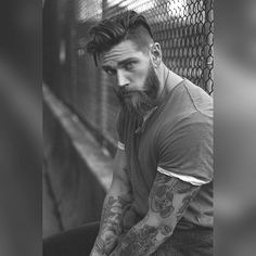 Chains, trains, and b&w Cranes @chrischampagne 's. #beardedwarrior #mensfashion #blackandwhitephotography #beardgang #beardsandtattoos #guyswithtattoos #vancity #604 #beardsandtats #tattooedmen #blueeyedboy