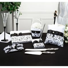 Black and White Wedding Set - Each piece in our Black and White Wedding Set is covered in a beautiful white satin. This wedding set features an elegant floral design in black. Each piece also has a black satin ribbon and bow that is adorned with a rhinestones in the center. #weddingsets #wedding #daisydays