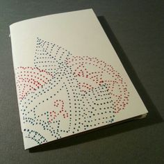 Hand made notebook in recycled paper. Paisley and flower illustration with 3D color