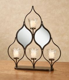 The Shanley Candelabra Table Accent shines exquisite beauty from all angles. Openwork metal tabletop candelabra holds your tealight or votive candles. Candle Stands, Candle Holders, Votive Candles, Candle Sconces, Tea Lights, Wall Lights, Party Stores, Light Up, Planters