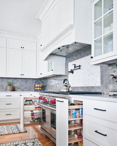 Beautiful AND practical. Would you ever consider adding a pot filler faucet to your kitchen? Modern Pot Fillers, Kitchen Pantry, Kitchen Cabinets, Pot Filler Faucet, Kitchen Design Gallery, Stainless Steel Hose, Kitchen Fixtures, Diy Garden Decor, Entertainment Center