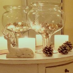 Decorate for Christmas - small table vignette with candles. Very simple and gives off a warm beautiful glow