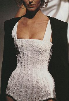 A beaded one-piece with major suction.  Thierry Mugler S/S 1998 (Eva Herzigova).