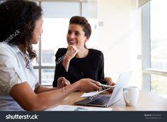 Two Businesswomen Using Laptop Computer Office Stock Photo ...