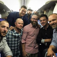 Chicago Cubs players getting their group photo taken while traveling.