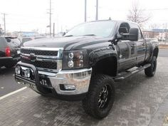Lifted 2014 Chevy Silverado 2500HD Southern Comfort Black Widow http://www.onlyliftedtrucks.com