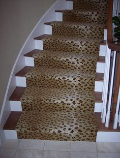 An animal print stair runner, in this case leopard, is a great way to add some interest to an entry way. #carpet, #animalprint, #leopard, #stairs
