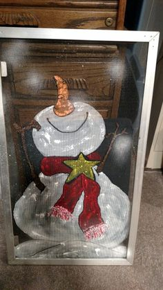 Old window screen with painted snowman