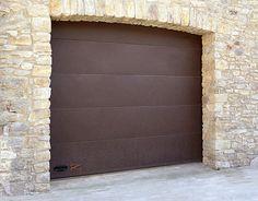 Porta da garage sezionale / di alluminio / in corten / automatica - ALUCOMIR - PORTES BISBAL S.A. (ANGEL MIR)