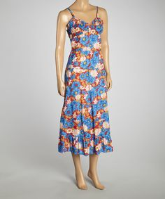 Step+into+this+breezy,+bright+dress+for+some+fun+in+the+sun!+This+elegant+floral+frock+boasts+lightweight+straps,+a+modish+mid-calf+length+and+breathable+cotton+for+just+the+right+amount+of+flow.