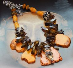 Slip on this necklace and make a bold statement without a lot of fuss.... This chunky tribal style necklace features a treasure trove of gemstones including tiger eye, golden magnesite slabs,...@ artfire