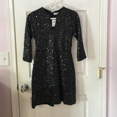 Abercrombie & Fitch Sequin Dress Size small, brand new with tags. Black with silver sequins, quarter sleeves with zip up from the back! Abercrombie & Fitch Dresses Mini