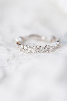 This wedding ring is so beautiful he dainty and feminine.