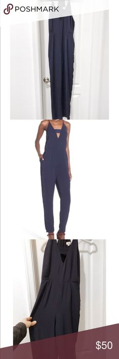 Storee Navy Blue Cutout Jumpsuit from Nordstrom Shop Women's Storee Blue size S  Understated yet incredibly sexy sleek jumpsuit. I've worn it once for my birthday and absolutely loved it. I wore it wit a fitter leather bomber jacket and pumps. I got so many compliments on it. I'd love to keep it but I just got one similar as a gift, so time to move on! storee Other