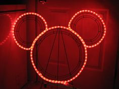 3 wire frames connected by cable ties and then add rope light and connect by cable ties to make this Mickey wreath