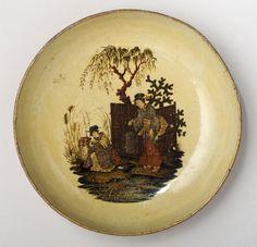 Papier-mache round dish with Chinese ladies on yellow background,