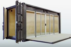 Ecopod container conversion. The decking folds up to shudder all the glass, which makes it work for the area.